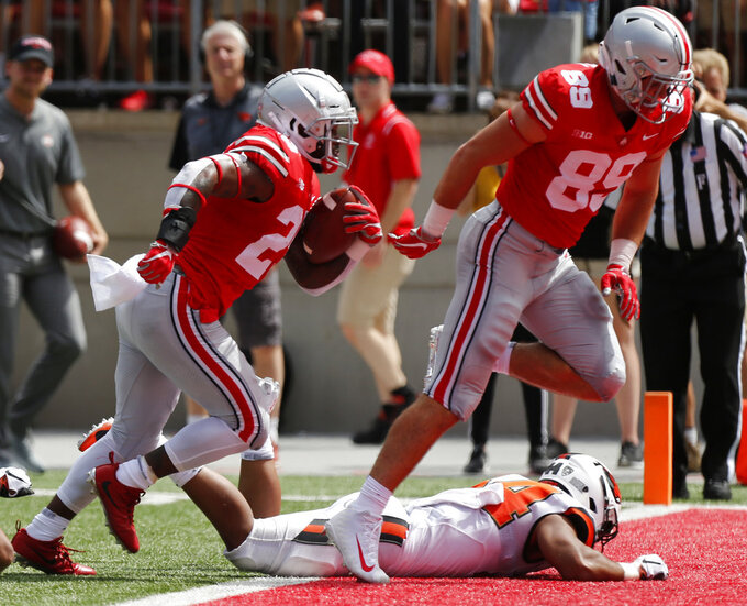 Ohio State running back Mike Weber, left, follows teammate tight end Luke Farrell into the end zone against Oregon State during the first half of an NCAA college football game Saturday, Sept. 1, 2018, in Columbus, Ohio. (AP Photo/Jay LaPrete)