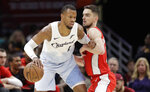 FILE- In this Jan. 29, 2019, file photo Cleveland Cavaliers' Rodney Hood, left, drives past Washington Wizards' Tomas Satoransky, from Czech Republic, in the second half of an NBA basketball game in Cleveland. The Cavaliers traded Hood to the Portland Trail Blazers. In exchange for Hood, Cleveland received guards Nik Stauskas and Wade Baldwin and a second-round pick in 2021 and 2023. The teams agreed to the deal on Sunday and completed their trade conference call with the NBA on Monday, Feb. 4. (AP Photo/Tony Dejak, File)