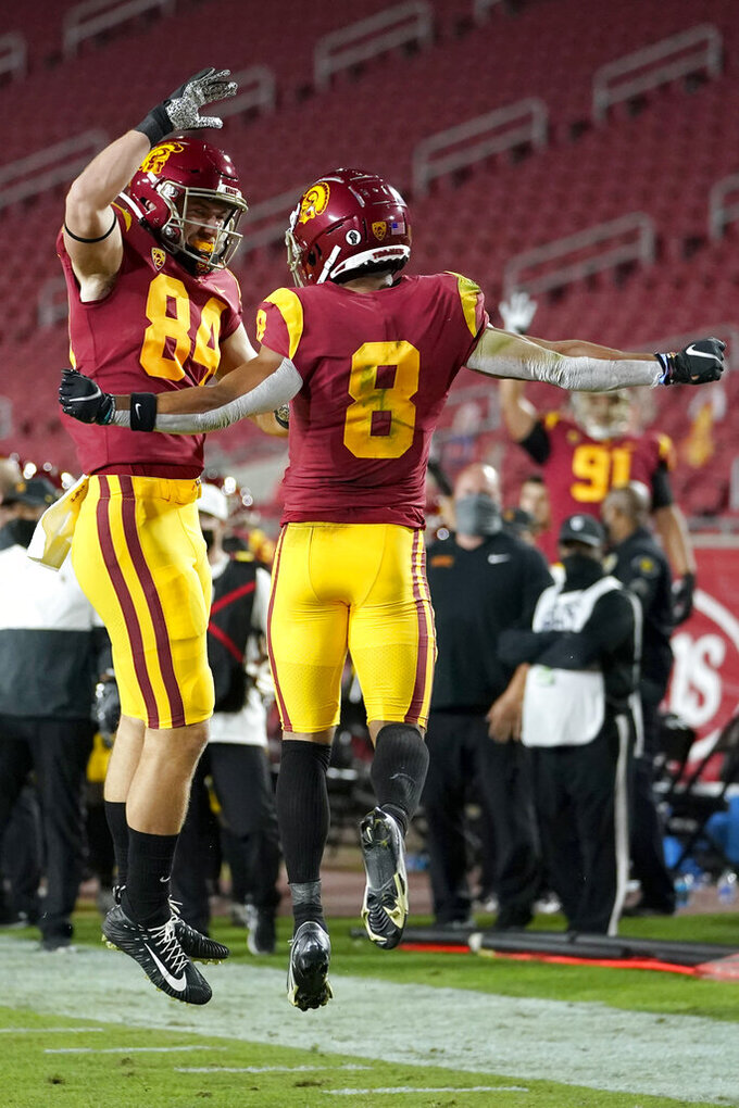 Southern California wide receiver Amon-Ra St. Brown, right, celebrates a touchdown run with tight end Erik Krommenhoek during the first half of an NCAA college football game against the Washington State in Los Angeles, Sunday, Dec. 6, 2020. (AP Photo/Alex Gallardo)