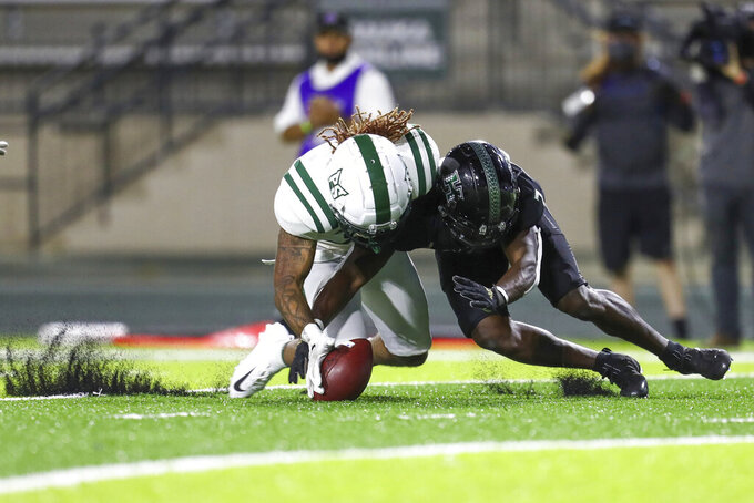 Portland State linebacker Isaiah Henry, left, and Hawaii running back Calvin Turner Jr. battle for a loose ball during the second half of an NCAA college football game, Saturday, Sept. 4, 2021, in Honolulu. (AP Photo/Darryl Oumi)