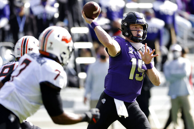 FILE - In this Dec. 5, 2020, file photo, TCU quarterback Max Duggan (15) throws downfield against Oklahoma State during the first half of an NCAA college football game in Fort Worth, Texas. Junior quarterback Max Duggan and the Frogs play their season opener Saturday night against FCS team Duquesne. (AP Photo/Ron Jenkins, File)