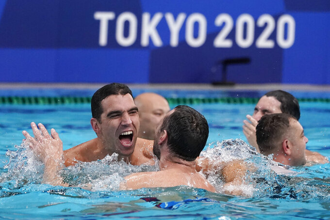 Serbia players celebrate after defeating Greece in the men's water polo gold medal match at the 2020 Summer Olympics, Sunday, Aug. 8, 2021, in Tokyo, Japan. (AP Photo/Mark Humphrey)