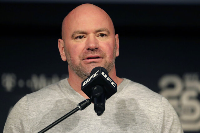 """FILE - In this Nov. 2, 2018, file photo, UFC president Dana White speaks at a press conference in New York. The UFC is returning to competition on May 9 with three shows in eight days in Jacksonville, Florida. The mixed martial arts promotion announced its plans Friday, April 24, 2020, to return to action after postponing and canceling several shows due to the coronavirus pandemic. Dana White also plans to hold shows on May 13 and May 16 at the same arena in Florida. Only """"essential personnel"""" will be in the arena, according to White. (AP Photo/Julio Cortez, File)"""