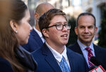 Transgender student Drew Adams speaks with reporters outside of the 11th Circuit Court of Appeals on Thursday, Dec. 5, 2019, in Atlanta. Adam's fight over school bathrooms comes before a federal appeals court Thursday, setting the stage for a groundbreaking ruling. Adams, who has since graduated from Nease High School in Ponte Vedra, won a lower court ruling last year ordering the St. Johns County school district to allow him to use the boys' restroom. The district has since appealed. (AP Photo/ Ron Harris)