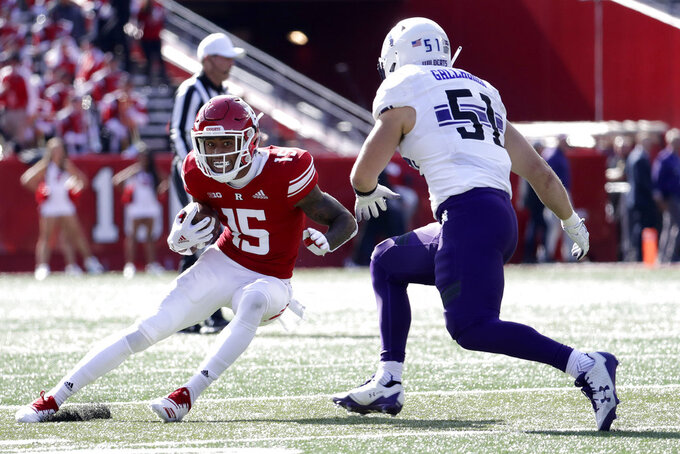 Rutgers wide receiver Shameen Jones, left, runs with the ball as Northwestern linebacker Blake Gallagher moves in for the tackle during the second half of an NCAA college football game, Saturday, Oct. 20, 2018, in Piscataway, N.J. Northwestern won 18-15. (AP Photo/Julio Cortez)