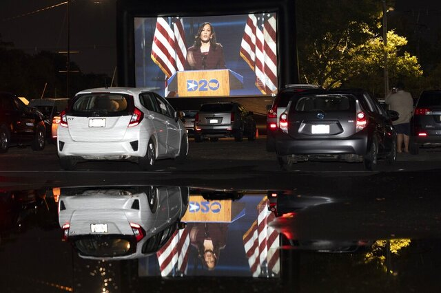 Democratic vice presidential nominee Kamala Harris speaks during the Democratic National Convention, as seen on a screen at a drive-in watch party for the convention at Suffolk Downs, Wednesday, Aug. 19, 2020, in Boston. (AP Photo/Michael Dwyer)