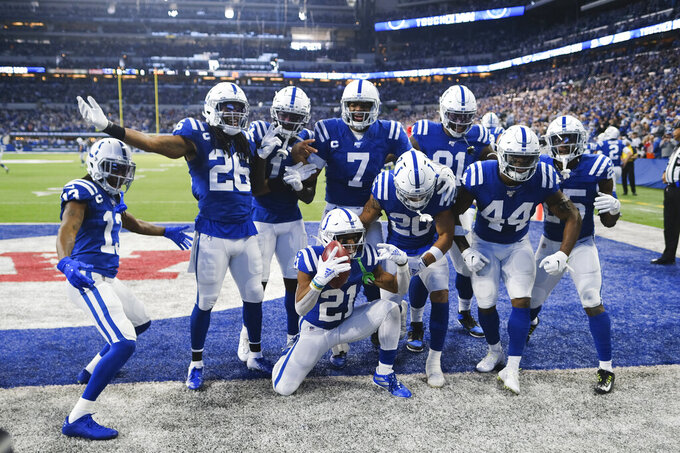 Indianapolis Colts running back Nyheim Hines (21) celebrates with teammates after running back a punt for a touchdown during the first half of an NFL football game against the Carolina Panthers, Sunday, Dec. 22, 2019, in Indianapolis. (AP Photo/AJ Mast)