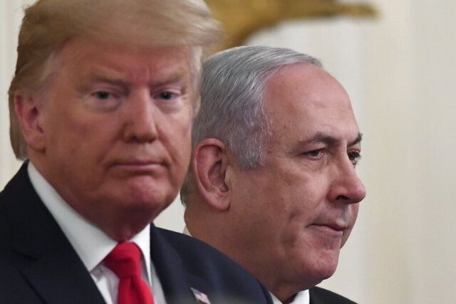 President Donald Trump, left, and Israeli Prime Minister Benjamin Netanyahu, right, during an event in the East Room of the White House in Washington, Tuesday, Jan. 28, 2020, to announce the Trump administration's much-anticipated plan to resolve the Israeli-Palestinian conflict. (AP Photo/Susan Walsh)