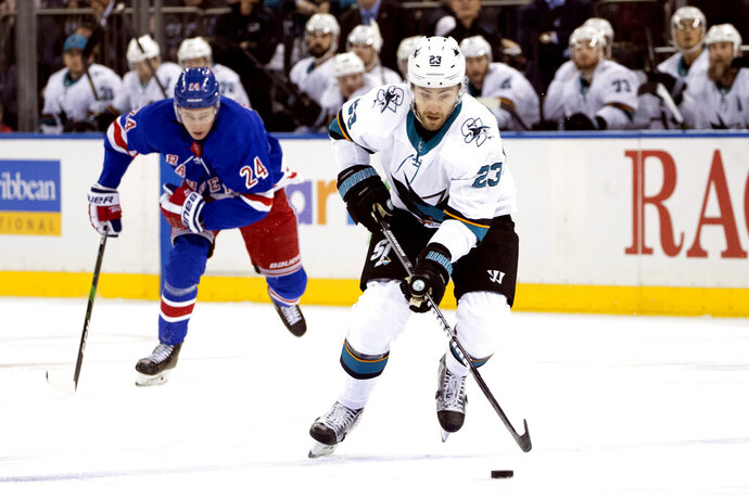 San Jose Sharks right wing Barclay Goodrow (23) controls the puck ahead of New York Rangers right wing Kaapo Kakko (24) during the first period of an NHL hockey game, Saturday, Feb. 22, 2020, at Madison Square Garden in New York. (AP Photo/Mary Altaffer)