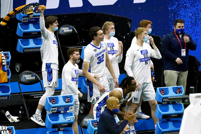 Creighton players watch the action in the final moments of the second half of a college basketball game against UC Santa Barbara in the first round of the NCAA tournament at Lucas Oil Stadium in Indianapolis Saturday, March 20, 2021. Creighton won 63-62. (AP Photo/Mark Humphrey)