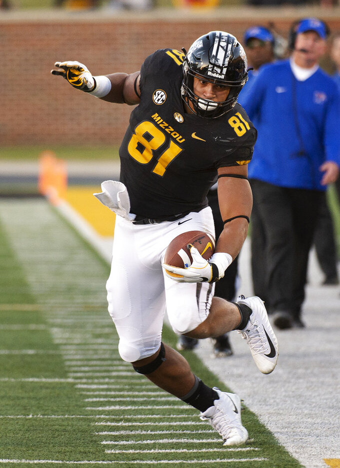 Missouri tight end Albert Okwuegbunam dances along the sideline after a reception during the second half of an NCAA college football game against Memphis, Saturday, Oct. 20, 2018, in Columbia, Mo. Missouri won the game 65-33. (AP Photo/L.G. Patterson)