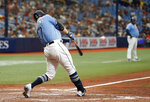 Tampa Bay Rays' Austin Meadows hits a two-run home run against the Minnesota Twins during the fifth inning of a baseball game on Sunday, Sept. 5, 2021, in St. Petersburg, Fla. (AP Photo/Scott Audette)