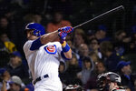 Chicago Cubs' Patrick Wisdom watches his two-run single off Minnesota Twins relief pitcher Jorge Alcala during the sixth inning of a baseball game Tuesday, Sept. 21, 2021, in Chicago. (AP Photo/Charles Rex Arbogast)