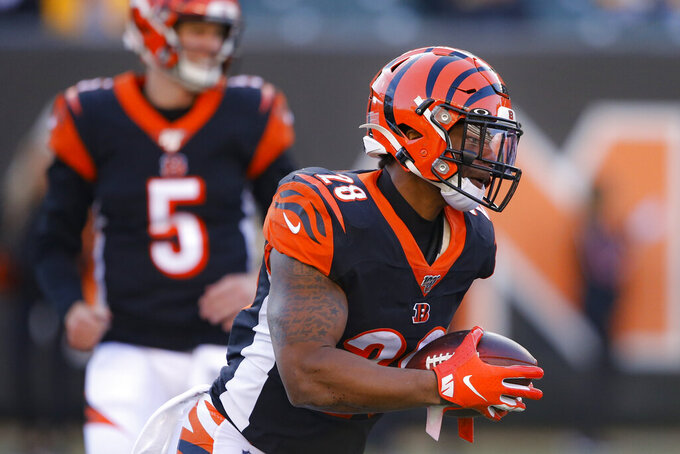 Cincinnati Bengals running back Joe Mixon runs the ball during the second half an NFL football game against the Pittsburgh Steelers, Sunday, Nov. 24, 2019, in Cincinnati. (AP Photo/Gary Landers)