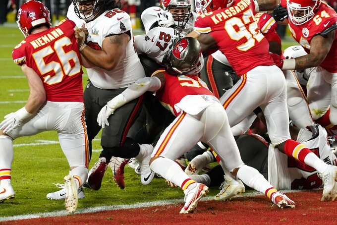 Tampa Bay Buccaneers running back Ronald Jones (27) is stopped short of the goal line on fourth down by Kansas City Chiefs' Ben Nieman (56), Tanoh Kpassagnon (92) and others during the first half of the NFL Super Bowl 55 football game, Sunday, Feb. 7, 2021, in Tampa, Fla. (AP Photo/Chris O'Meara)