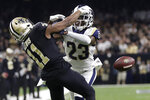 "FILE - In this Jan. 20, 2019, file photo, Los Angeles Rams' Nickell Robey-Coleman breaks up a pass intended for New Orleans Saints' Tommylee Lewis during the second half of the NFL football NFC championship game in New Orleans. With ""The Catch"" that sent San Francisco to its first Super Bowl and ""The Blown Call"" that kept New Orleans at home, NFC championship games have two seminal moments that rank with just about any in postseason history. (AP Photo/Gerald Herbert, File)"