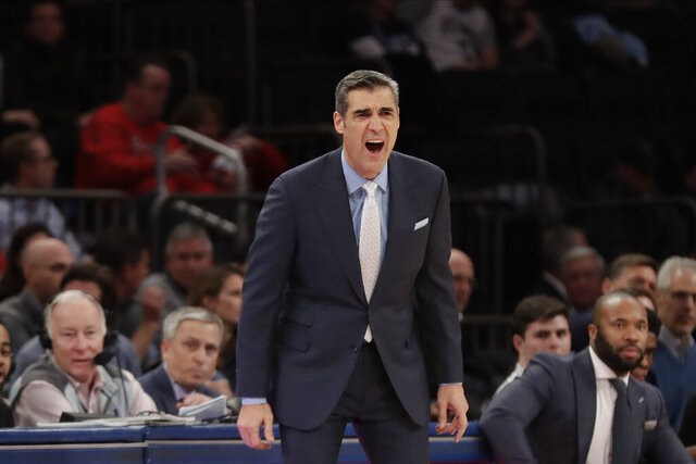 FILE - In this Jan. 28, 2020 file photo, Villanova head coach Jay Wright calls out to his team during the second half of an NCAA college basketball game against St. John's in New York.   The Villanova Wildcats are again the favorite to win the Big East and are No. 3 in The Associated Press' preseason 2020-21 college basketball poll.  Wright's Wildcats received 11 first-place votes in the AP poll.  (AP Photo/Frank Franklin II, File)