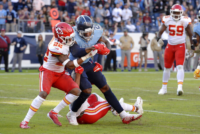 Tennessee Titans running back Derrick Henry pushes against Kansas City Chiefs free safety Juan Thornhill, left, in the second half of an NFL football game Sunday, Nov. 10, 2019, in Nashville, Tenn. (AP Photo/Mark Zaleski)