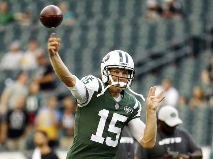 FILE - In this Aug. 30, 2018, file photo, New York Jets' Josh McCown warms up before a preseason NFL football game against the Philadelphia Eagles in Philadelphia. McCown will start at quarterback for the Jets against the Buffalo Bills on Sunday in place of injured rookie Sam Darnold. (AP Photo/Matt Rourke, File)