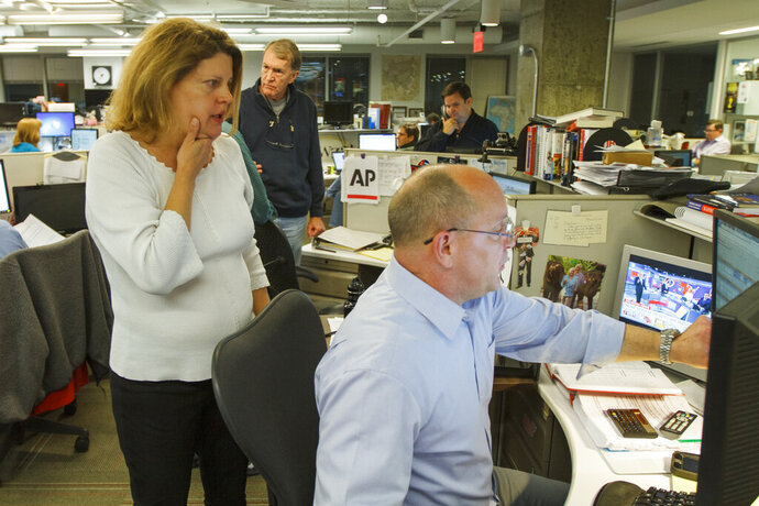 "Then-Associated Press Washington bureau chief Sally Buzbee, talks with Stephen Ohlemacher, who in 2020 is the decision desk editor, in the early morning hours of Wednesday, Nov. 9, 2016, at the Washington bureau of The Associated Press during election night. The Associated Press, one of several news organizations whose declarations of winners drive election coverage, is pulling back the curtain in 2020 to explain how it is reaching those conclusions. ""The general public has a more intense desire to understand it at a nitty-gritty level,"" said Buzbee, who is now senior vice president and executive editor. (AP Photo/Jon Elswick)"