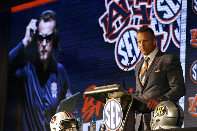 Auburn head coach Bryan Harsin speaks to reporters during an NCAA college football news conference at the Southeastern Conference media days, Thursday, July 22, 2021, in Hoover, Ala. (AP Photo/Butch Dill)