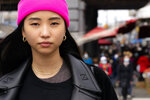 """Teresa Ting stands for a portrait, Wednesday, March 31, 2021, in the Flushing neighborhood of the Queens borough of New York. The vicious assault of a 65-year-old woman while walking to church this week near New York City's Times Square has heightened already palpable levels of outrage over anti-Asian attacks that started with the pandemic. Ting, a 29-year-old Chinese American, started what has become the Main Street Patrol following an attack on another older Asian American woman in February. """"It literally could have been my mother had it been the wrong place, wrong time,"""" Ting said of that attack. (AP Photo/John Minchillo)"""