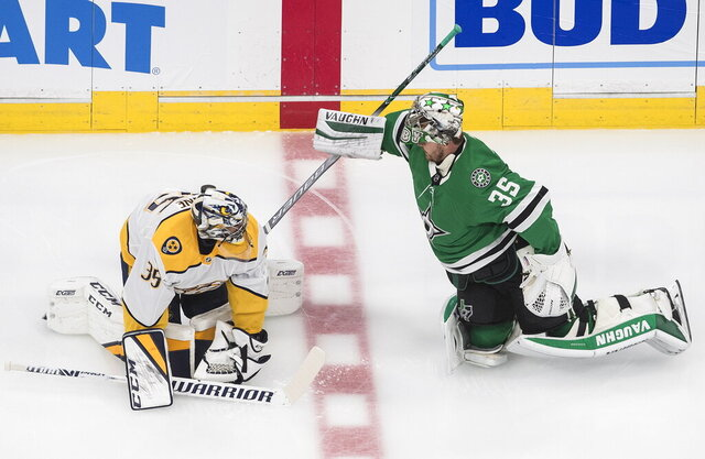 Nashville Predators goalie Pekka Rinne (35) and Dallas Stars goalie Anton Khudobin (35) chat during warm ups before an exhibition NHL hockey game in Edmonton, Alberta, Thursday, July 30, 2020. (Jason Franson/The Canadian Press via AP)