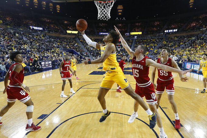 Michigan guard Jordan Poole (2) drives against Indiana in the first half of an NCAA college basketball game in Ann Arbor, Mich., Sunday, Jan. 6, 2019. (AP Photo/Paul Sancya)