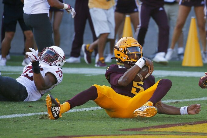 Arizona State quarterback Jayden Daniels (5) scores a touchdown as he eludes Washington State safety Skyler Thomas (25) during the second half of an NCAA college football game Saturday, Oct. 12, 2019, in Tempe, Ariz. (AP Photo/Ross D. Franklin)