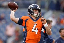 Denver Broncos quarterback Brett Rypien (4) warms up prior to an NFL preseason football game against the Arizona Cardinals, Thursday, Aug. 29, 2019, in Denver. (AP Photo/Jack Dempsey)