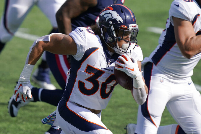 Denver Broncos running back Phillip Lindsay carries the ball in the first half of an NFL football game against the New England Patriots, Sunday, Oct. 18, 2020, in Foxborough, Mass. (AP Photo/Steven Senne)