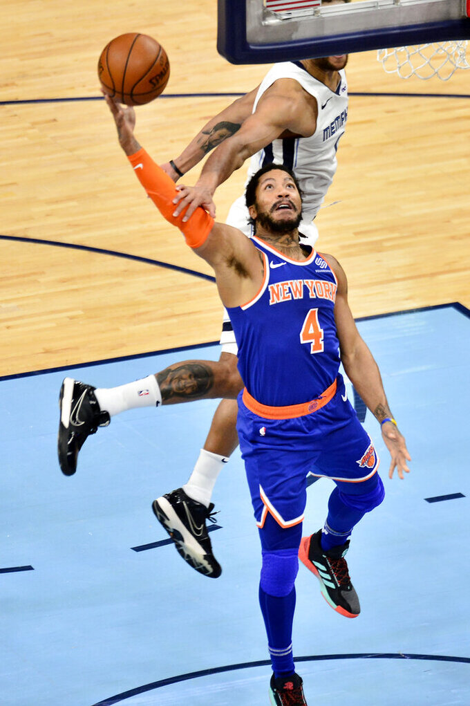 New York Knicks guard Derrick Rose (4) shoots against Memphis Grizzlies forward Kyle Anderson in the second half of an NBA basketball game Monday, May 3, 2021, in Memphis, Tenn. (AP Photo/Brandon Dill)