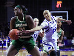 Kansas State forward Kali Jones (15) reaches in on Baylor center Kalani Brown (21) during the second half of an NCAA college basketball game in Manhattan, Kan., Wednesday, Feb. 13, 2019. (AP Photo/Orlin Wagner)