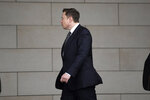 Tesla CEO Elon Musk arrives at U.S. District Court Wednesday, Dec. 4, 2019, in Los Angeles. Musk is going on trial for his troublesome tweets in a case pitting the billionaire against a British diver he allegedly dubbed a pedophile. (AP Photo/Mark J. Terrill)