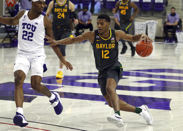 TCU guard RJ Nembhard (22) defends as Baylor guard Jared Butler (12) drives the ball in the second half  of an NCAA college basketball game, Saturday, Jan. 9, 2021, in Fort Worth, Texas. (AP Photo/ Richard W. Rodriguez)