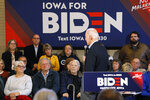 Audience members listen to Democratic presidential candidate former Vice President Joe Biden speak during a bus tour stop, Tuesday, Dec. 3, 2019, in Mason City, Iowa. (AP Photo/Charlie Neibergall)