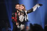 Maluma, left, and Madonna perform