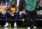 Cleveland Cavaliers forward LeBron James sits on the bench during a timeout in the second half in Game 2 of the team's NBA basketball Eastern Conference finals against the Boston Celtics, Tuesday, May 15, 2018, in Boston. (AP Photo/Charles Krupa)