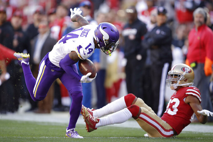 Minnesota Vikings wide receiver Stefon Diggs (14) runs for a touchdown past San Francisco 49ers cornerback Ahkello Witherspoon, right, during the first half of an NFL divisional playoff football game, Saturday, Jan. 11, 2020, in Santa Clara, Calif. (AP Photo/Ben Margot)