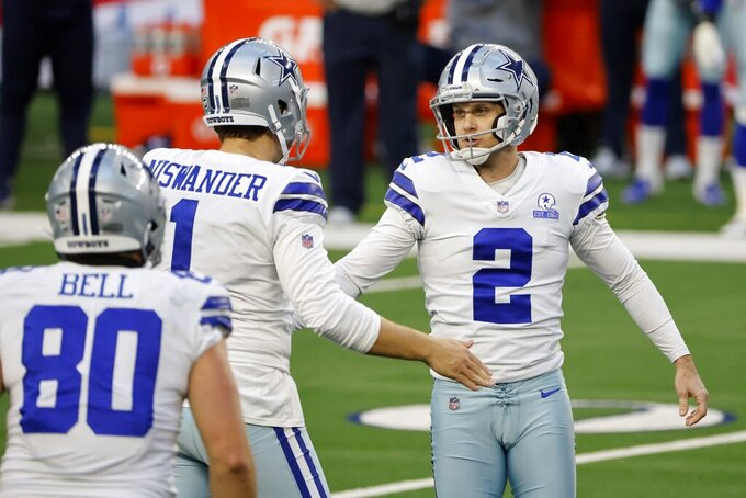 Dallas Cowboys' Blake Bell (80), Hunter Niswander (1) and Greg Zuerlein (2) celebrate a field goal kicked by Zuerlein late in the second half of an NFL football game against the San Francisco 49ers in Arlington, Texas, Sunday, Dec. 20, 2020. (AP Photo/Michael Ainsworth)