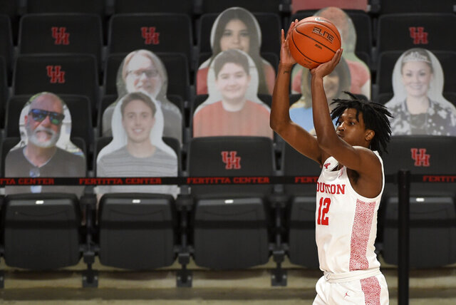 Houston guard Tramon Mark shoots a 3-point basket during the second half of an NCAA college basketball game against Lamar, Wednesday, Nov. 25, 2020, in Houston. (AP Photo/Eric Christian Smith)