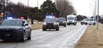 Law enforcement vehicles escort Nebraska Medical Center vehicles leaving Eppley Airfield in Omaha, Neb., on Monday, Feb 17, 2020. American citizens who were on a cruise ship off Japan's coast who were at high risk of being exposed to the novel coronavirus were flown to Omaha and taken to the University of Nebraska Medical Center campus after landing. (Z Long/Omaha World-Herald via AP)