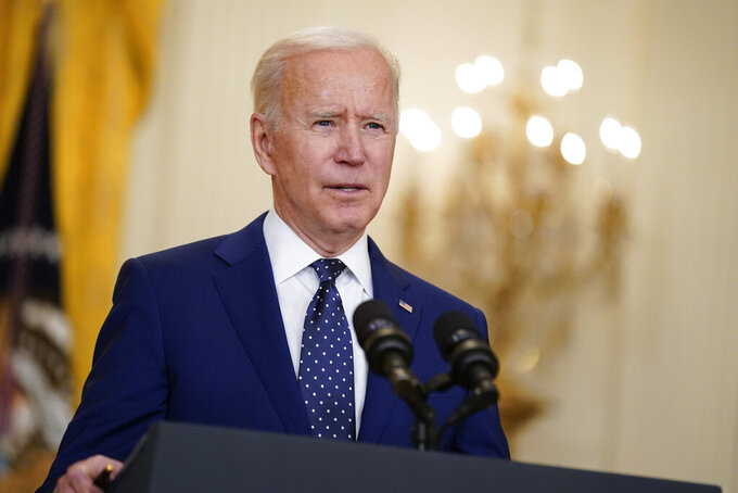 FILE - In this April 15, 2021, file photo, President Joe Biden speaks in the East Room of the White House in Washington. No nation offers asylum or other protections to people displaced because of climate change. Biden's administration is studying the idea, and climate migration is expected to be discussed at his first climate summit.  (AP Photo/Andrew Harnik, File)