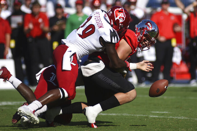 Louisville defensive end Tabarius Peterson (29) sacks Western Kentucky quarterback Steven Duncan (10) causing a fumble in the first half of an NCAA college football game, Saturday, Sept. 14, 2019, in Nashville, Tenn. (AP Photo/Mike Strasinger)