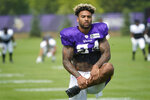 Minnesota Vikings tight end Irv Smith stretches during the NFL football team's training camp Wednesday, Aug. 4, 2021, in Eagan, Minn. (AP Photo/Jim Mone)