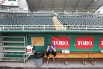 Minnesota Twins catcher Mitch Garver talks on his phone in an empty Hammond Stadium, Thursday, March 12, 2020, in Fort Myers, Fla. Major League Baseball has suspended the rest of its spring training game schedule because if the coronavirus outbreak. The league is also delaying the start of its regular season by at least two weeks. (AP Photo/Elise Amendola)