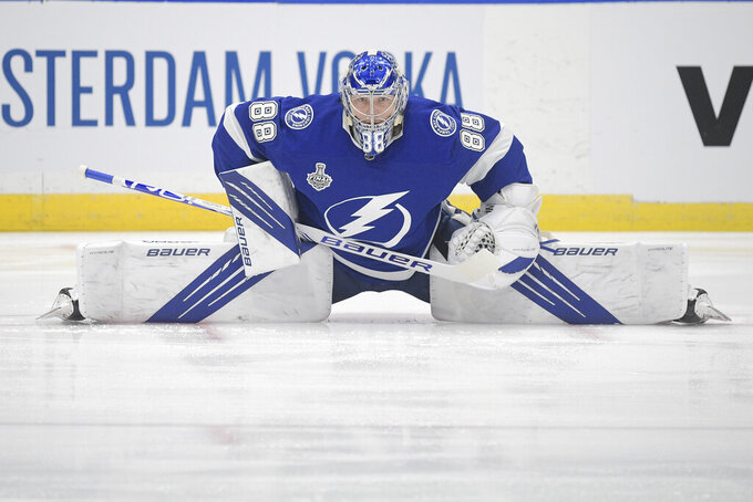 Tampa Bay Lightning goaltender Andrei Vasilevskiy stretches before the first period in Game 1 of the NHL hockey Stanley Cup finals against the Montreal Canadiens, Monday, June 28, 2021, in Tampa, Fla. (AP Photo/Phelan Ebenhack)