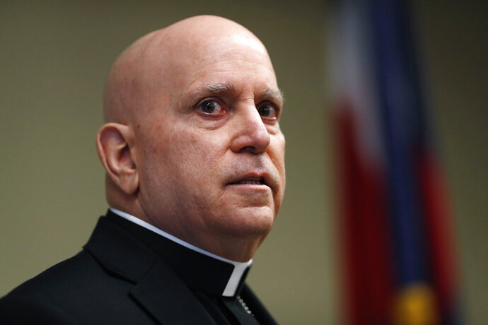 Samuel Aquila, archbishop of the Denver diocese of the Roman Catholic Church, speaks about the plan to have a former federal prosecutor review the sexual abuse files of Colorado's Roman Catholic dioceses at a news conference Tuesday, Feb. 19, 2019, in Denver. The church will pay reparations to victims under a voluntary joint effort with the state attorney general. (AP Photo/David Zalubowski)