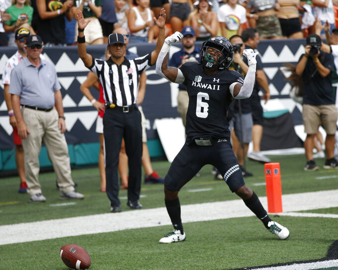 Hawaii wide receiver Cedric Byrd II (6) celebrates his first-quarter touchdown against Arizona during an NCAA college football game Saturday, Aug. 24, 2019, in Honolulu. (AP Photo/Marco Garcia)