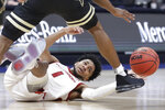 Arkansas guard Isaiah Joe (1) reaches for the ball as he falls in the second half of an NCAA college basketball game against Vanderbilt in the Southeastern Conference Tournament Wednesday, March 11, 2020, in Nashville, Tenn. Arkansas won 86-73. (AP Photo/Mark Humphrey)